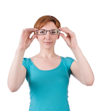 one teenage girl only: Young woman lookin thru glasses