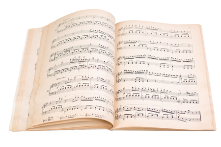 old book with music note isolated on white