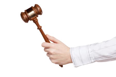 subpoena: Gavel in hand on white