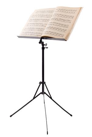 白い背景に分離されたピアノのノートと譜面台 写真素材