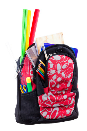 bookbag: Nice decorative backpack or bookbag with school supplies isolated on white background