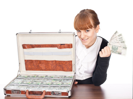 criminal activity: Brown briefcase full of hundred zloty money isolated on white