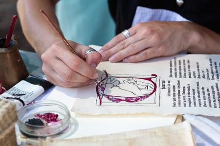 restoring: Woman artist Restoring antique Books