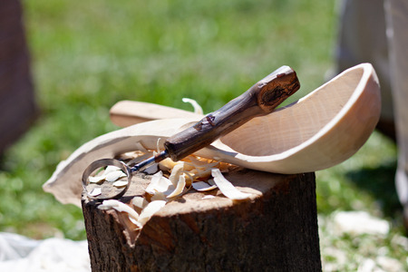 hand carved: Hand carved wooden spoon with carving tools Stock Photo