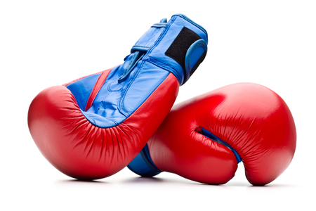 combative sport: Red boxing gloves on white