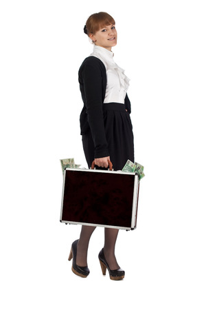 overflowing: Image of a woman holding a briefcase overflowing with money