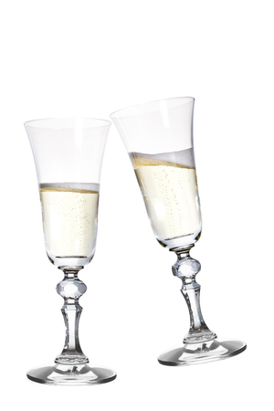 festive occasions: Pair of champagne flutes making a toast. Isolated on white