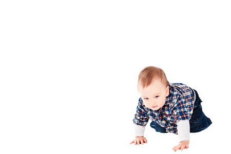 six month old: Six month old baby boy proud and happy crawling. Copy space left.