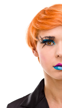 red head woman: Half womans face with crazy makeup. Focused on the eyes.
