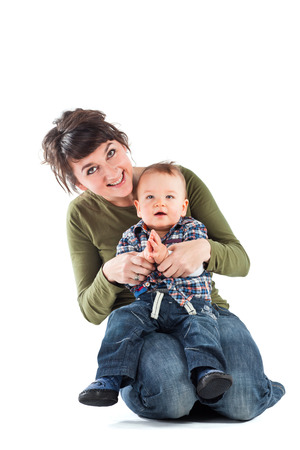 6 12 months: Little baby with mother. Studio shot. Stock Photo