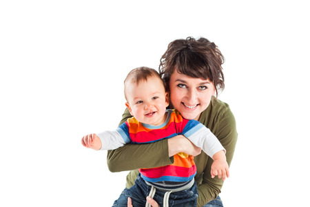 6 12 months: Little baby boy with mother. Studio shot.