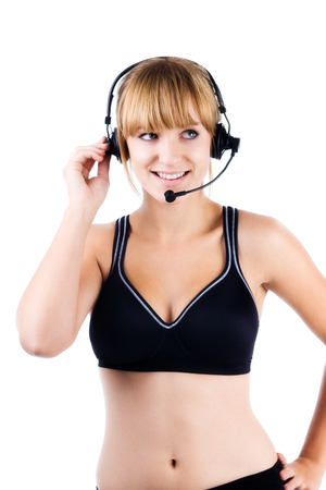 trainer device: Aerobics instructor wearing wireless microphone on white background Stock Photo