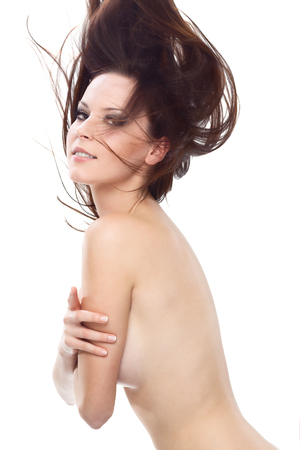 girls naked: Gorgeous sexy naked girl hiding her breast with her arm, looking at the camera Stock Photo