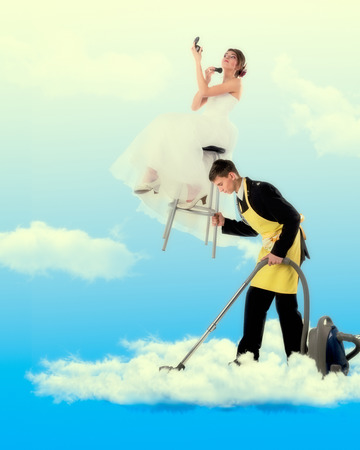 full length mirror: Woman sitting on the stool holding a mirror, man hoovering in clouds.