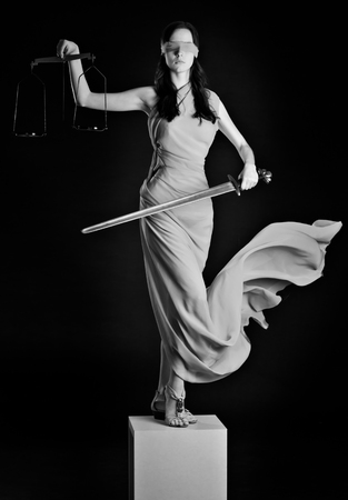 blind justice: Statue of justice. Blind Woman with scale and sword.
