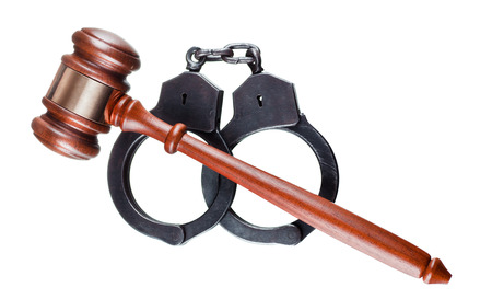 restraints: Gavel and handcuffs isolated on white Stock Photo