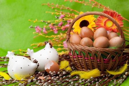 eastertime: Basket full of Easter eggs and flower