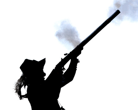 musketeer: Silhouette of man stooting rifle Stock Photo