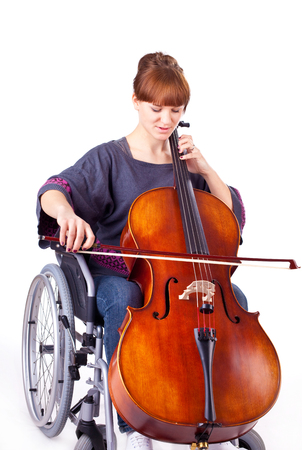 resonate: invalid girl with cello on wheelchair isolated on white