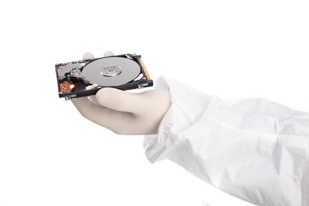 白い背景で隔離の手でハード ディスク 写真素材