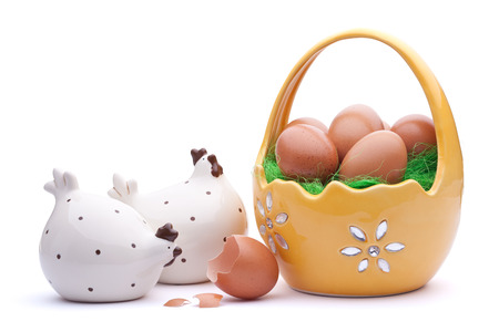Basket full of Easter eggs with chicken