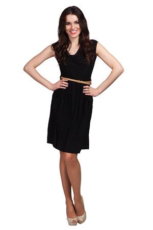 若いかわいい女性が黒のドレスでポーズ