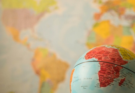 Africa map on a globe with the whole world as background