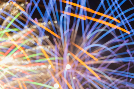 Fireworks display at bonfire 4th of November celebration, Kenilworth Castle, united kingdom intentionally defocused as a background.