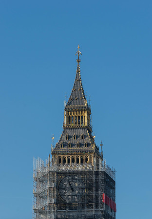 LONDON, UK - October 17th, 2017: close up of Scaffolding around the Elizabeth Tower, more commonly known as Big Ben, during the extensive restoration and repairs of the Houses of Parliament. Editorial