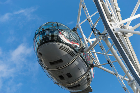 LONDON, UK - October 17th, 2017: Close up of the London Eye in London, England with tourism holding capsule in view. Editorial