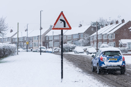 COVENTRY, UNITED KINGDOM 10-12-2017: heavy snowfall, cars covered by snow and traffic affected. Editorial