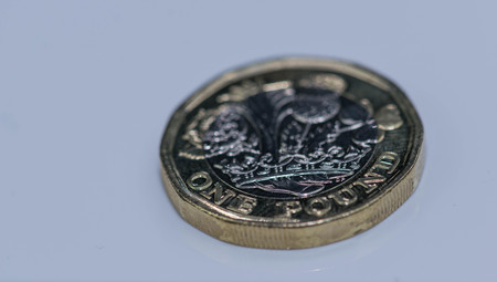 Close up focus photos of new United kingdom Pound coin isolated on a white background