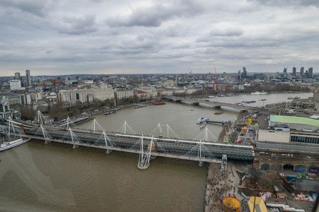 London, United Kingdom, February 17, 2018: Aerial view of London cityscape with the Hungerford Bridge over the river Thames