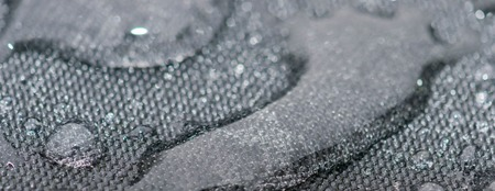 Closeup detailed view of raindrops on a fabric, a background. Stockfoto