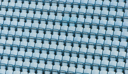 Rows of a blue stadium plastic seats.