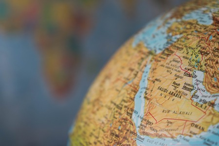 Africa and middle east map on a globe with earth map in the background