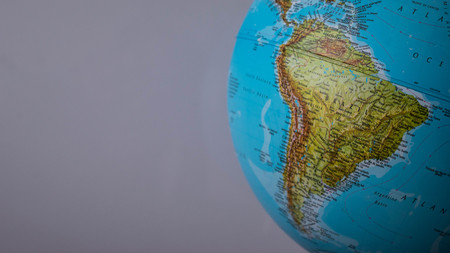South America map on a globe with a white background