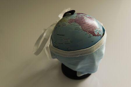 World globe wearing surgical mask to fight corona virus covid 19 pandemic