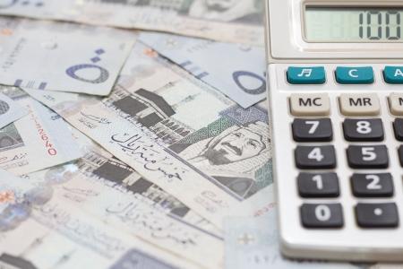 gcc: Saudi Money with Calculator  Stock Photo