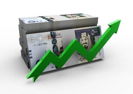 KSA: piles of Saudi Arabia money with green arrow on isolated white background