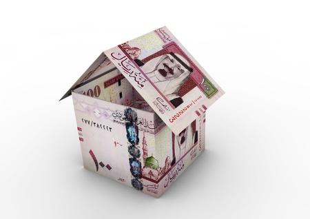 3D Saudi money shaped as house origami isolated on white background photo