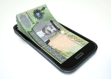 arabic currency: Mobile phone with Bahrain money isolated on white background Stock Photo