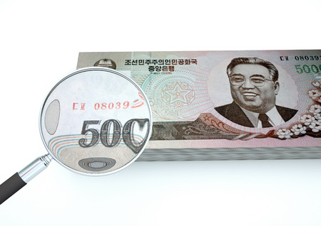 3D Rendered North Korea money with magnifier investigate currency isolated on white background Stock Photo