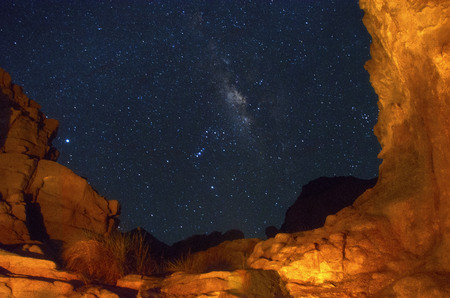 Surrounded by the red sea mountains using the camp fire along with a low shutter technique, to capture this photo. Enjoying the night sky with the fire mountains.