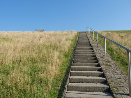 Stairs on the dike Stock Photo