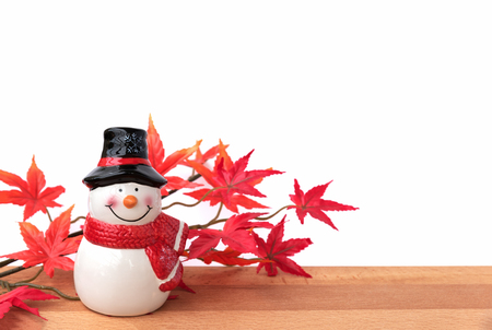 greeting season: Snowman with maple leaf, this is season greeting for joyful and happiness, santa claus is coming in town, merry christmas Stock Photo