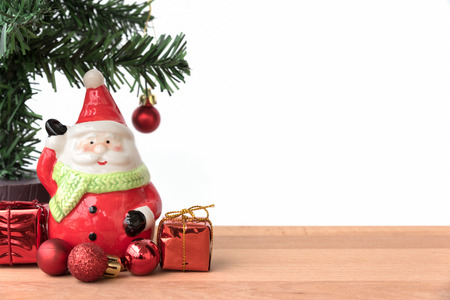 greeting season: Santa claus with the christmas tree and the gift box, this is season greeting for joyful and happiness