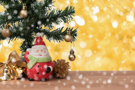 greeting season: Santa claus with the gift and christmas tree with golden decoration, this is season greeting for joyful and happiness Stock Photo