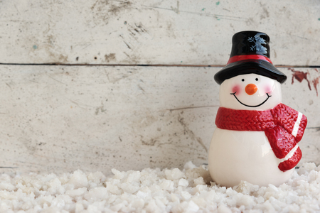 holiday decor: snowman on the snow in vintage background Stock Photo