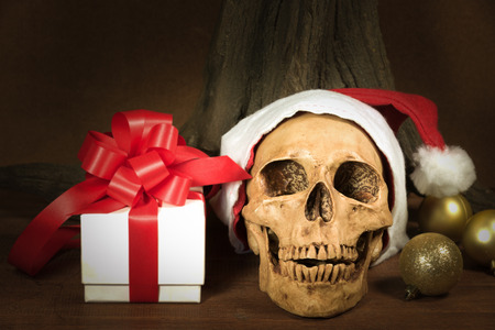 Still life with skull and present, santa is coming to town, dark concept